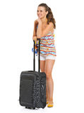 Happy tourist woman with bag looking on copy space Stock Photography