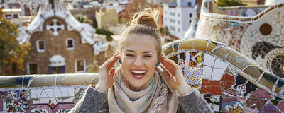 Happy tourist woman in Barcelona, Spain sitting on bench Royalty Free Stock Photos