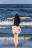 Happy tourist woman feeling happy at the sea Royalty Free Stock Image