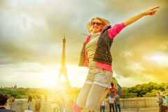 Woman jumping at Eiffel Tower royalty free stock photo