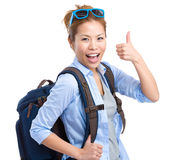 Happy tourist woman with thumb up Stock Images
