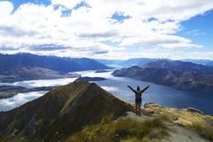 Happy tourist woman on top of Roys Peak Royalty Free Stock Photos