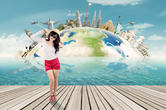 Happy tourist and the world monument background Royalty Free Stock Image