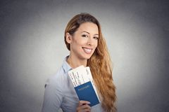 Happy tourist young woman holding passport holiday flight ticket Stock Photo