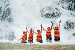 Happy tourists canyoning at Datanla waterfall in Vietnam Stock Photos