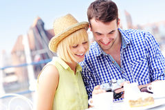Happy tourists checking their pictures Royalty Free Stock Image
