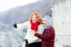 Happy tourists in city. Urban lifestyle of aged people. Guy and girl happy from seeing side. Holidays of two people outside city. Royalty Free Stock Images