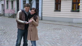 Happy tourists couple using city map stock video footage
