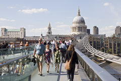 Happy tourists crossing millenium bridge Royalty Free Stock Images
