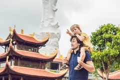 Happy tourists dad and son in Pagoda. Travel to Asia concept. Traveling with a baby concept.  Stock Photo