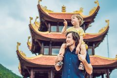 Happy tourists dad and son in Pagoda. Travel to Asia concept. Traveling with a baby concept.  Stock Image