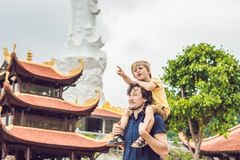 Happy tourists dad and son in Pagoda. Travel to Asia concept. Tr. Aveling with a baby concept stock photos