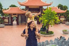 Happy tourists dad and son in Pagoda. Travel to Asia concept. Tr. Aveling with a baby concept stock photography