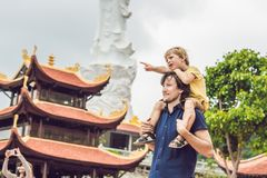 Happy tourists dad and son in Pagoda. Travel to Asia concept. Traveling with a baby concept.  royalty free stock photos