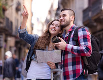 Happy tourists on excursion. Happy tourists enjoying excursion over european town seeing sights and taking pictures Royalty Free Stock Photography