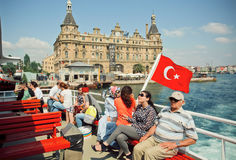 Happy tourists on a ferry across the Bosphorus watching historical Istanbul Stock Photography