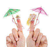 Happy tourists finger puppets. Caricature made of a finger puppet representing a happy couple Royalty Free Stock Photography