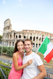 Happy tourists in front of Coliseum, Rome, Italy Royalty Free Stock Images