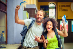 Happy tourists holding tickets for holiday Royalty Free Stock Photography