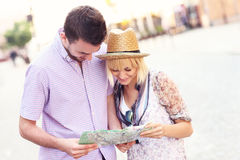 Happy tourists with a map Stock Photography