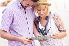 Happy tourists with a map Royalty Free Stock Image