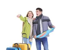 Happy tourists with map. On white background Royalty Free Stock Image