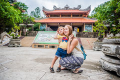 Happy tourists mom and son in LongSon Pagoda. Happy tourists mom and son in Long Pagoda. Travel to Asia concept. Traveling with a baby concept stock photo