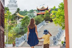 Happy tourists mom and son in Pagoda. Travel to Asia concept. Tr. Aveling with a baby concept royalty free stock photos
