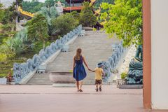 Happy tourists mom and son in Pagoda. Travel to Asia concept. Traveling with a baby concept.  Royalty Free Stock Photo