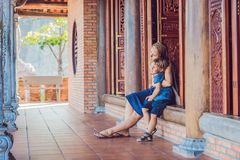 Happy tourists mom and son in Pagoda. Travel to Asia concept. Traveling with a baby concept.  royalty free stock photography