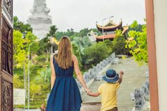 Happy tourists mom and son in Pagoda. Travel to Asia concept. Traveling with a baby concept.  Stock Photos