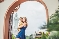 Happy tourists mom and son in Pagoda. Travel to Asia concept. Traveling with a baby concept.  stock photography