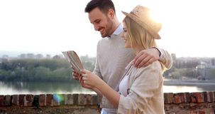 Free Happy Tourists Sightseeing City With Map Royalty Free Stock Photography - 103832487