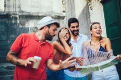 Happy tourists sightseeing in city stock photo