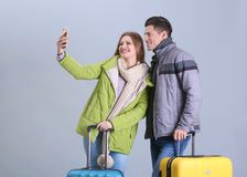 Happy tourists with suitcases taking selfie royalty free stock image