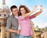 Happy tourists taking photo of themselves Royalty Free Stock Images
