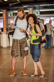 Happy tourists with tickets. Happy tourists holding tickets for holiday Royalty Free Stock Photos
