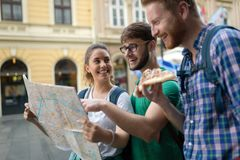 Happy tourists traveling and sightseeing. City Stock Photos