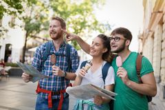 Happy tourists traveling and sightseeing. City Stock Photo