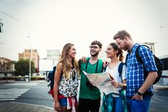 Happy tourists traveling and sightseeing. In city Royalty Free Stock Photography