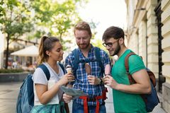 Happy tourists traveling and sightseeing stock photos