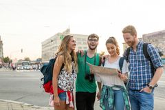 Happy tourists traveling and sightseeing. In city Stock Photos