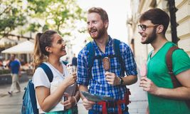 Happy tourists traveling and sightseeing. Happy young tourists traveling and sightseeing city Stock Images