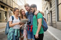 Happy tourists travelling and sightseeing. City Stock Photo
