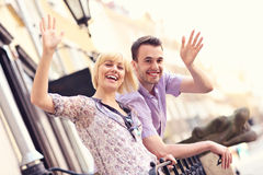 Happy tourists waving to the camera Royalty Free Stock Photo