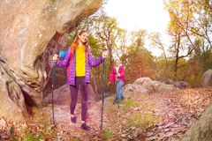 Happy tourists exploring mountain trails in autumn Stock Photos