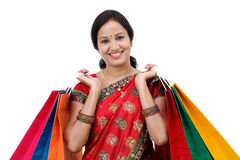 Happy traditional Indian woman with shopping bags Stock Photography