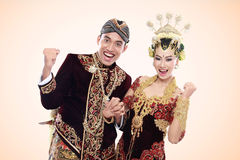 Happy traditional java wedding couple Stock Photos