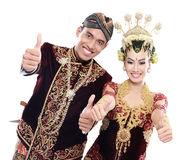 Happy traditional java wedding couple with thumbs up Royalty Free Stock Images
