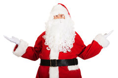 Happy traditional Santa Claus showing a copyspace Royalty Free Stock Images
